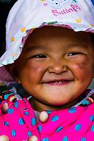 A young Tibetan girl laughing. Tibet (Xizang), China.