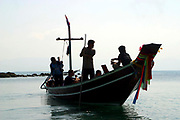 Western tourist travel on a local taxi boat to various parts of the island from the port of Hat Rin, Koh Phangnan, Thailand