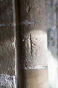 Crucifix cross symbol  carved into stone of doorway entrance to the historic village parish church Marden, Wiltshire, England, UK - reputedly marks left by those going off to the Crusades