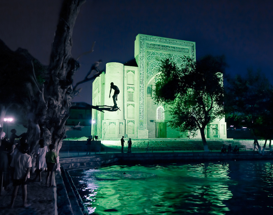 Children dive into the ancient central pond of Bukhara.