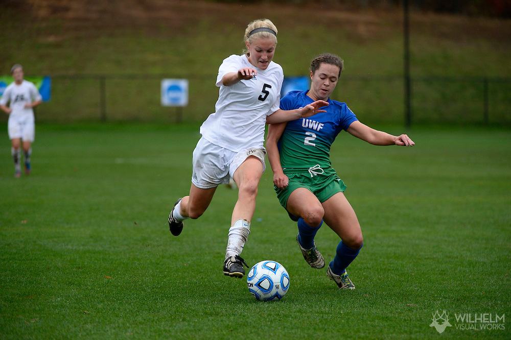 07 DEC 2013: Kendra Stauffer (5) of Grand Valley State University takes on Taylor Harbinson (2) of the University of West Florida during the 2013 NCAA Women's Division II Soccer Championship held at Blanchard Woods Park in Evans, GA. Grand Valley State defeated West Florida 2-0 to win the national title. © Brett Wilhelm