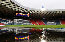 Puddles beside the pitch before the 2018 FIFA World Cup Qualifying, Group F match at Hampden Park, Glasgow.