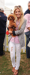 Asprey World Class Cup polo held at Hurtwood Park Polo Club, Ewhurst, Surrey on 17th July 2010.<br /> Picture shows:- MOLLIE KING from The Saturdays holding her dog Alfie