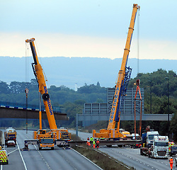 © Licensed to London News Pictures. 28/08/2016<br /> M20 BRIDGE COLLAPSE,KENT.<br /> The M20 is still closed today after a pedestrian bridge collapsed on to the motorway after being struck by a digger on a transporter lorry.  Emergency work to clear the scene is continuing with engineers working all night.<br /> (Byline:Grant Falvey/LNP)