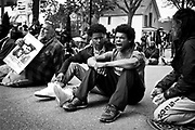 Jordan King, right, chants while blocking traffic along Williamson Street after a prosecutor said that a police officer will not face charges in the fatal shooting of an unarmed 19-year-old biracial man, in Madison, Wisconsin May 12, 2015. Tony Robinson Jr. was shot in the head, torso and right arm by Officer Matt Kenny, who police have said was responding to a report that a man who had battered someone was dodging traffic in the street when he encountered Robinson. REUTERS/Ben Brewer
