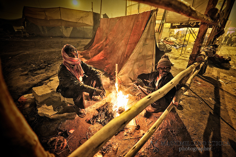After Holy Bath on Mauni Amawasya day Pilgrims cannot afford a tent pass over the night near the banks of Sangam, on the roads of Allahabd or near the Shashtri Bridge pillars, waiting for the early morning to bathe in holy river..
