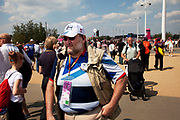 London, UK. Thursday 9th August 2012. London 2012 Olympic Games Park in Stratford. A Team GB fan smoking a large pipe.