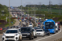 © Licensed to London News Pictures. 29/05/2021. Luton, UK. Long queues of traffic on the M1 motorway south of Luton . Large numbers of people are travelling at the start of the Bank Holiday Weekend as sunny weather and the easing of Coronavirus lockdown restrictions enable freer movement across the country . Photo credit: Joel Goodman/LNP