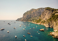 Aerial view of boats gathered in the sea off Capri, Bay of Naples, during summer, Southern Italy.