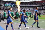 Players walk out onto the pitch before 2 play off final match between AFC Wimbledon and Plymouth Argyle at Wembley Stadium, London, England on 30 May 2016. Photo by Stuart Butcher.
