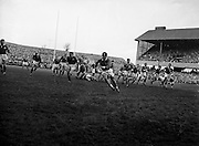 The forward lines in action, .Dupuy, the French left wing, who later scored for France, pictured centre, about to gain possession despite effort of Irish captain, Dawson on left,.and the whole Irish forward line in the background, after a scrum near the half way line,..Irish Rugby Football Union, Ireland v France, Five Nations, Landsdowne Road, Dublin, Ireland, Saturday 18th April, 1959,.18.4.1959, 4.18.1959,..Referee- D G Walters, Welsh Rugby Union, ..Score- Ireland 9 - 5 France, ..Irish Team, ..N J Henderson, Wearing number 15 Irish jersey, Full Back, N.I.F.C, Rugby Football Club, Belfast, Northern Ireland, ..A J O'Reilly, Wearing number 14 Irish jersey, Right Wing, Old Belvedere Rugby Football Club, Dublin, Ireland, and, Leicester Rugby Football Club, Leicester, England, ..M K Flynn, Wearing number 13 Irish jersey, Right Centre, Wanderers Rugby Football Club, Dublin, Ireland, ..D Hewitt, Wearing number 12 Irish jersey, Left centre, Queens University Rugby Football Club, Belfast, Northern Ireland,..N H Brophy, Wearing number 11 Irish jersey, Left wing, University College Dublin Rugby Football Club, Dublin, Ireland, ..M A F English, Wearing number 10 Irish jersey, Outside Half, Bohemians Rugby Football Club, Limerick, Ireland,..A A Mulligan, Wearing number 9 Irish jersey, Scrum Half, London Irish Rugby Football Club, Surrey, England, ..B G Wood, Wearing number 1 Irish jersey, Forward, Garryowen Rugby Football Club, Limerick, Ireland, ..A R Dawson, Wearing number 2 Irish jersey, Captain of the Irish team, Forward, Wanderers Rugby Football Club, Dublin, Ireland, ..S Millar, Wearing number 3 Irish jersey, Forward, Ballymena Rugby Football Club, Antrim, Northern Ireland,..W A Mulcahy, Wearing number 4 Irish jersey, Forward, University College Dublin Rugby Football Club, Dublin, Ireland, ..M G Culliton, Wearing number 5 Irish jersey, Forward, Wanderers Rugby Football Club, Dublin, Ireland, ..N Murphy, Wearing number 6 Irish jersey, Forward, Cork Constitution Rugby Footb