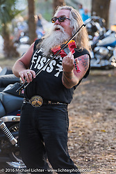 Harry Fryed of the Fryed Brothers Band plays in between sets at the Broken Spoke Saloon. Daytona Bike Week 75th Anniversary event. FL, USA. Wednesday March 9, 2016.  Photography ©2016 Michael Lichter.