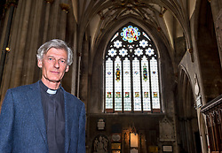 "© Licensed to London News Pictures; 16/06/2020; Bristol, UK. Picture of Revd Canon MICHAEL JOHNSON, Acting Dean of Bristol, in front of the north window in Bristol Cathedral. Bristol Cathedral has this week covered up the name of Edward Colston on the giant north window, the largest stained glass window in the cathedral and known as the ""Colston window"", in the ongoing controversy over the 17th century slave trader and philanthropist's place in Bristol's history and the many references to him in the city. The inscription that has been covered up read ""To the Glory of God and in Memory of Edward Colston 1636 – 1721"" The cathedral's action comes just over a week after the statue of Edward Colston which stood in Bristol city centre for over 100 years was pulled down by protestors and thrown in Bristol Docks during a Black Lives Matters rally and march through the city centre. The rally was held in memory of George Floyd, a black man who was killed on May 25, 2020 in Minneapolis in the US by a white police officer kneeling on his neck for nearly 9 minutes. The killing of George Floyd has seen widespread protests in the US, the UK and other countries against both modern day racism and historical legacies of slavery. Edward Colston (1636 – 1721) was a wealthy Bristol-born English merchant involved in the slave trade, a Member of Parliament and a philanthropist. He supported and endowed schools, almshouses, hospitals and churches in Bristol, London and elsewhere, and his name is commemorated in several Bristol landmarks, streets, three schools and the Colston bun. References to Edward Colston have also been removed or covered up at St Mary Redcliffe church in Bristol. Photo credit: Simon Chapman/LNP."