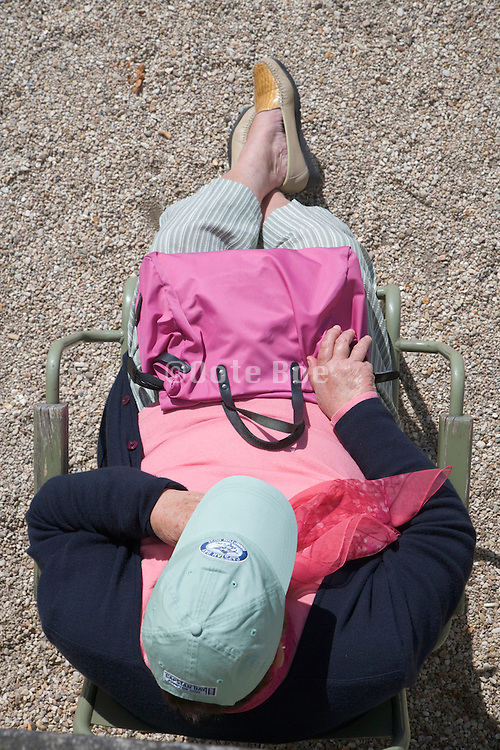 overhead view of a senior woman resting in a chair