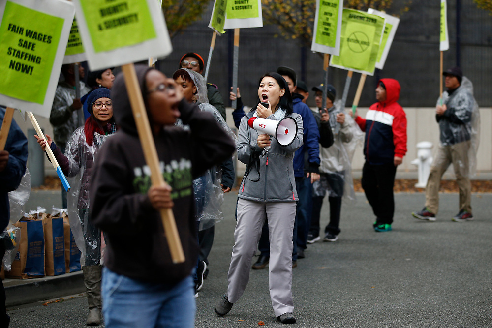 AFSCME 3299 union coordinator Ching Lee protests and leads a march outside the William J. Rutter Center as the Regents of the University of California meet inside, Wednesday, Nov. 15, 2017, in San Francisco, Calif. Demonstrators demanded the resignation of one of the regents, Norman Pattiz.