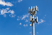 Antennas for 3 sector multi-site cellular  communications  mobile telephone system on a monopole tower in South Australia, Australia. <br />