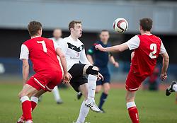 Edinburgh City's Mark McDonnell and Brora Rangers Martin McLean and Scott Houston.<br /> Edinburgh City 1 v 1 Brora Rangers, 1st leg, Pyramid Playoffs at Meadowbank, 25/4/2015.