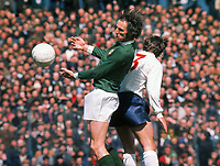 Football - 1971 British Home Championship - Northern Ireland 0 England 1 15/05/1971<br /> <br /> Derek Dougan of Northern Ireland is challenged by England's Terry Cooper at Windsor Park, Belfast.