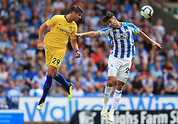 """Chelsea's Alvaro Morata (left) and Huddersfield Town's Christopher Schindler battle for the ball during the Premier League match at the John Smith's Stadium, Huddersfield. PRESS ASSOCIATION Photo. Picture date: Saturday August 11, 2018. See PA story SOCCER Huddersfield. Photo credit should read: Mike Egerton/PA Wire. RESTRICTIONS: EDITORIAL USE ONLY No use with unauthorised audio, video, data, fixture lists, club/league logos or """"live"""" services. Online in-match use limited to 120 images, no video emulation. No use in betting, games or single club/league/player publications."""