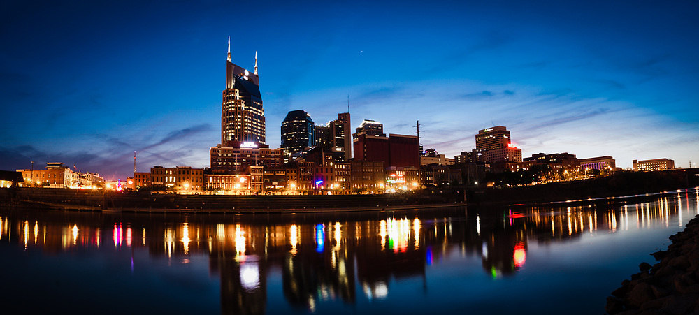 The Nashville Skyline is reflected in the Cumberland river after sunset.