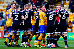 Mansfield Town and Grimsby Town tussle on the pitch - Mandatory by-line: Ryan Crockett/JMP - 04/01/2020 - FOOTBALL - One Call Stadium - Mansfield, England - Mansfield Town v Grimsby Town - Sky Bet League Two