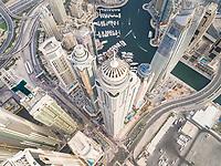 Aerial view of towers surrounding harbour in Dubai Marina, U.A.E.