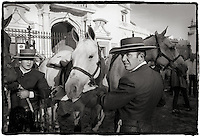 Black and white photo of a bullfighter with horses in Seville, Spain.