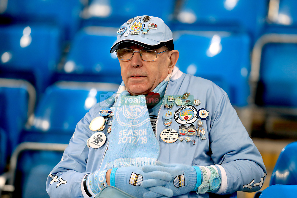 A Manchester City fan in the stands