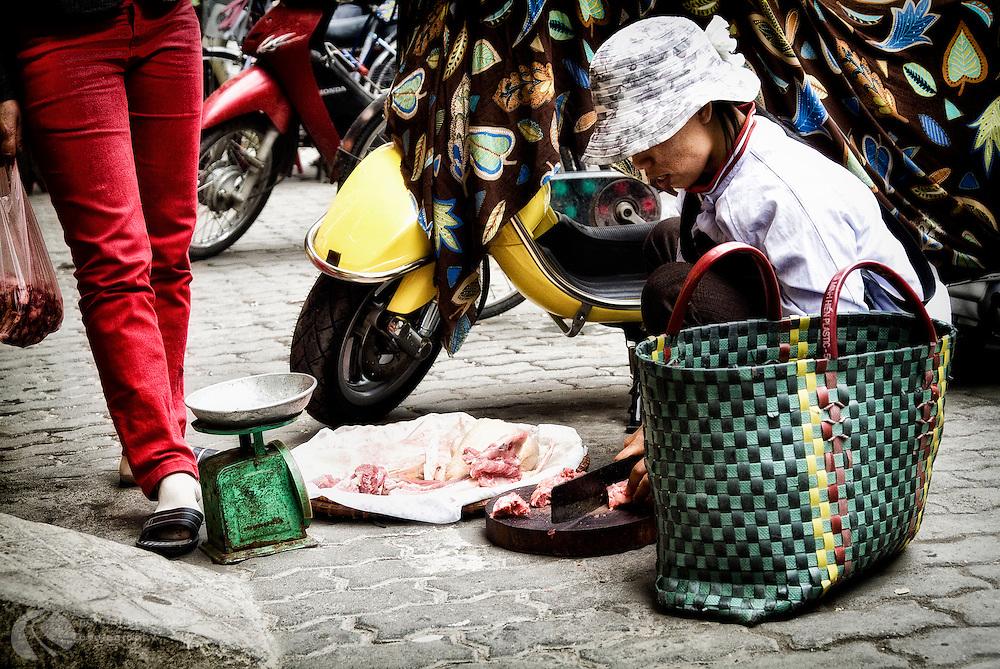 Downtown street butcher, Hanoi.