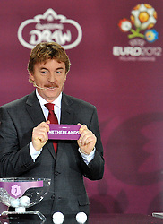 ZBIGNIEW BONIEK (POLAND) SHOWS THE TICKET OF NETHERLANDS DURING THE UEFA EURO 2012 QUALIFYING DRAW IN PALACE SCIENCE AND CULTURE IN WARSAW, POLAND..THE 2012 EUROPEAN SOCCER CHAMPIONSHIP WILL BE HOSTED BY POLAND AND UKRAINE...WARSAW, POLAND , FEBRUARY 07, 2010..( PHOTO BY ADAM NURKIEWICZ / MEDIASPORT / SPORTIDA.COM ).