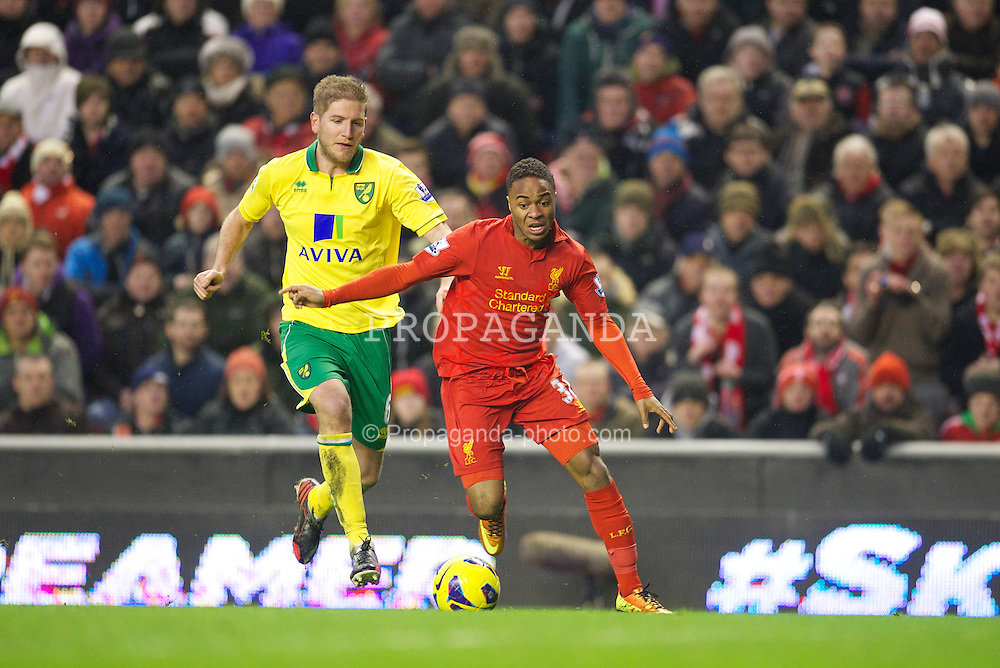 LIVERPOOL, ENGLAND - Saturday, January 19, 2013: Liverpool's Raheem Sterling on his way to setting up the fifth goal, an own-goal by Norwich City, during the Premiership match at Anfield. (Pic by David Rawcliffe/Propaganda)