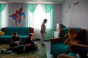 Boys in a recreation room at Vesnova Childrens Mental Asylum. Chernobyl's human costs are widespread affecting about seven million people.A generation later children are being born with birth defects ,heart problems and thyroid cancer.The crippled economy of Belarus has led to poverty, social problems and domestic abuse..Photograph by Eamon Ward