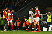 Manu Tuilagi of England shakes hands with George North of Wales after a dangerous tackle led to Tuilagi getting a red card during the Guinness Six Nations between England and Wales at Twickenham Stadium, Saturday, March 7, 2020, in London, United Kingdom. (Mitchell Gunn-ESPA-Images/Image of Sport)