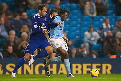 MANCHESTER, ENGLAND - Monday, February 25, 2008: Everton's Jolean Lescott and Manchester City's Mwaruwari Benjani during the Premiership match at the City of Manchester Stadium. (Photo by David Rawcliffe/Propaganda)