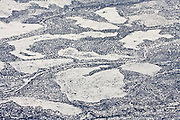 Aerial view of fresh snowfall highlights roads and fields cleared from the sagebrush-steppe in northern Arizona.