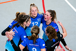 Team Zwolle celebrate with Nynke Hofstede of Zwolle, Iris Reinders of Zwolle, Bjorna Gras of Zwolle before the first league match between Djopzz Regio Zwolle Volleybal - Laudame Financials VCN on February 27, 2021 in Zwolle.
