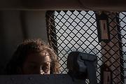 A migrant girl sits inside a U.S. Border Patrol transport van with fellow asylum seekers after the group of Central Americans turned themselves in following an illegal crossing of the Rio Grande near Mission, Texas, U.S., July 26, 2019.