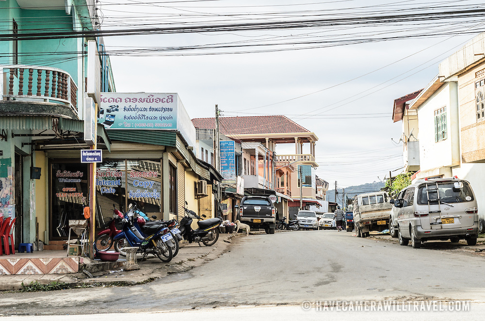 A dusty side-street in Phonsavan in northeastern Laos, capital of Xieng Khouang Province and a central town in the Plain of Jars. The people of the region are predominantly of Hmong ethnicity.