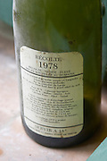 The first vintage 1978, 80% Cabernet Sauvignon, 20% Malbec, Merlot, Syrah, Cabernet Franc, Pinot and Tannat. Back label. Domaine du Mas de Daumas Gassac. in Aniane. Languedoc. France. Europe. Bottle.