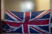 A crumpled British Union Jack flag in the window of a City retailer, on 2nd February 2017, in the City of London, England.