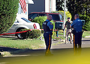 Police personnel investigate the scene of a stabbing murder