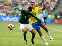 July 2, 2018 - Samara, Russia - July 2, 2018, Russia, Samara, FIFA World Cup 2018, 1/8 finals. Football match of Brazil - Mexico at the stadium Samara - Arena. Player of the national team Hugo Ayala (2), Philippe Coutinho  (Credit Image: © Russian Look via ZUMA Wire)