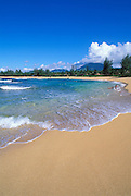 Local kids playing in the surf at Tunnels Beach, North Shore, Island of Kauai, Hawaii