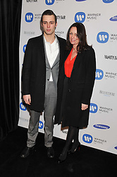 CLAUDE SIMONON and his mother TRISH SIMONON at the Warner Music Group Post Brit Awards Party in Association with Samsung held at The Savoy, London on 20th February 2013.
