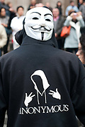 November 12th 2011 . Back view of  protester at St Paul's, part of Occupy London wearing a Guy Fawkes mask , trademark of Anonymous movement and based on character in the film V for Vendetta.