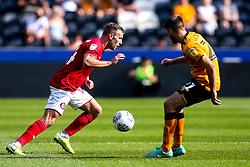 Andi Weimann of Bristol City takes on Brandon Fleming of Hull City - Mandatory by-line: Robbie Stephenson/JMP - 24/08/2019 - FOOTBALL - KCOM Stadium - Hull, England - Hull City v Bristol City - Sky Bet Championship