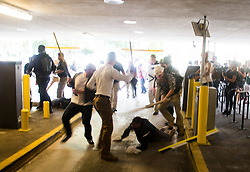 August 12, 2017 - Charlottesville, Virginia, U.S. - Several white supremacists attack a black man, bloodying him with wooden poles and part of a broken parking arm. (Credit Image: © Zach D Roberts/NurPhoto via ZUMA Press)