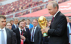 September 9, 2017 - Moscow, Russia - Russian President Vladimir Putin smiles holds the FIFA World Cup Trophy prior to starting the Trophy Tour event at the Luzhniki Grand Sports Arena September 9, 2017 in Moscow, Russia. The FIFA World Cup trophy will visit 24 Russian cities and 50 countries prior to the start of the World Cup Russia 2018. (Credit Image: © Kremlin Pool/Planet Pix via ZUMA Wire)