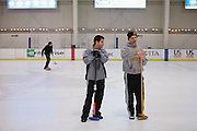 Ryan Winterbourne, left, and Brian Zaitz, both of San Jose, chat during the San Francisco Bay Area Curling Club's Tuesday night league at Sharks Ice in San Jose on Jan.15, 2013.