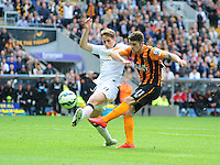 Hull City's Robbie Brady gets a shot in on goal under pressure from Manchester United's Adnan Januzaj<br /> <br /> Photographer Chris Vaughan/CameraSport<br /> <br /> Football - Barclays Premiership - Hull City v Manchester United - Sunday 24th May 2015 - Kingston Communications Stadium - Hull<br /> <br /> © CameraSport - 43 Linden Ave. Countesthorpe. Leicester. England. LE8 5PG - Tel: +44 (0) 116 277 4147 - admin@camerasport.com - www.camerasport.com